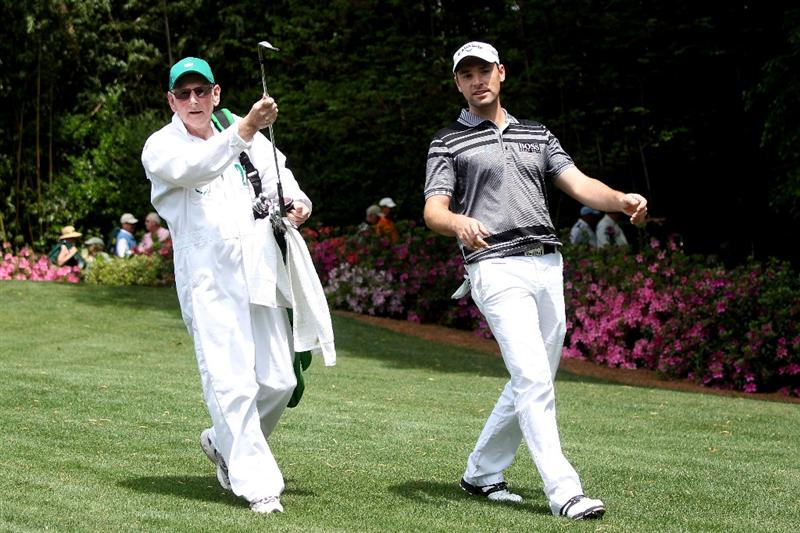 AUGUSTA, GA - APRIL 07:  Oliver Wilson of England (R) walks with his caddie/father during the Par 3 Contest prior to the 2010 Masters Tournament at Augusta National Golf Club on April 7, 2010 in Augusta, Georgia.  (Photo by Andrew Redington/Getty Images)