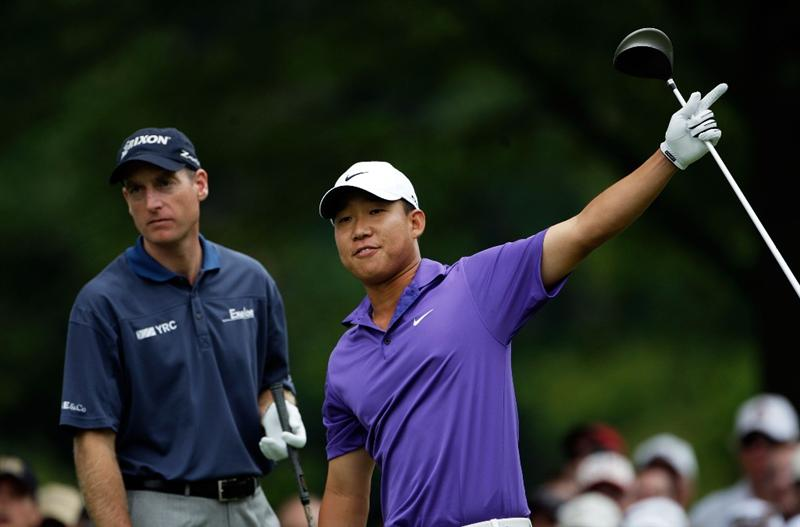 ST. LOUIS - SEPTEMBER 07:  Anthony Kim calls fore as Jim Furyk watches after hitting his first shot on the 4th hole during the final round of the BMW Championship on September 7, 2008 at Bellerive Country Club in St. Louis, Missouri.  (Photo by Jamie Squire/Getty Images)