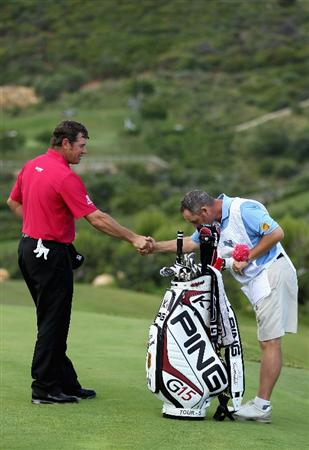 CASARES, SPAIN - MAY 20:  Lee Westwood of England shakes hands with his caddie Billy Foster after winning his match against Aaron Baddeley of Australia during the group stages of the Volvo World Match Play Championships at Finca Cortesin on May 20, 2011 in Casares, Spain.  (Photo by Warren Little/Getty Images)