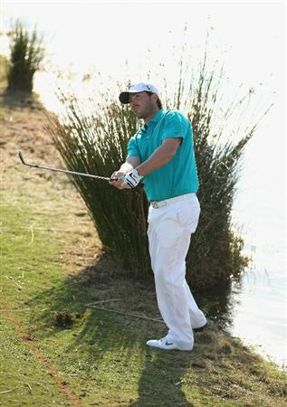 VILAMOURA, PORTUGAL - OCTOBER 16:  Pablo Martin of Spain plays into the 14th green from a water hazard during the third round of the Portugal Masters at the Oceanico Victoria Golf Course on October 16, 2010 in Vilamoura, Portugal.  (Photo by Richard Heathcote/Getty Images)