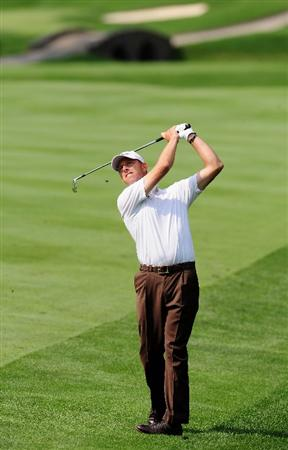 AKRON, OH - AUGUST 06:  Soren Hansen of Denmark plays his approach shot on the third hole during the first round of the World Golf Championship Bridgestone Invitational on August 6, 2009 at Firestone Country Club in Akron, Ohio.  (Photo by Stuart Franklin/Getty Images)