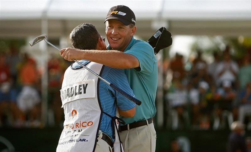 RIO GRANDE, PR - MARCH 15:  Michael Bradley hugs caddie Noah Zelnick after winning the 2009 Puerto Rico Open presented by Banco Popular at the Trump International Golf Club on March 15, 2009 in Rio Grande, Puerto Rico.  (Photo by Mike Ehrmann/Getty Images)