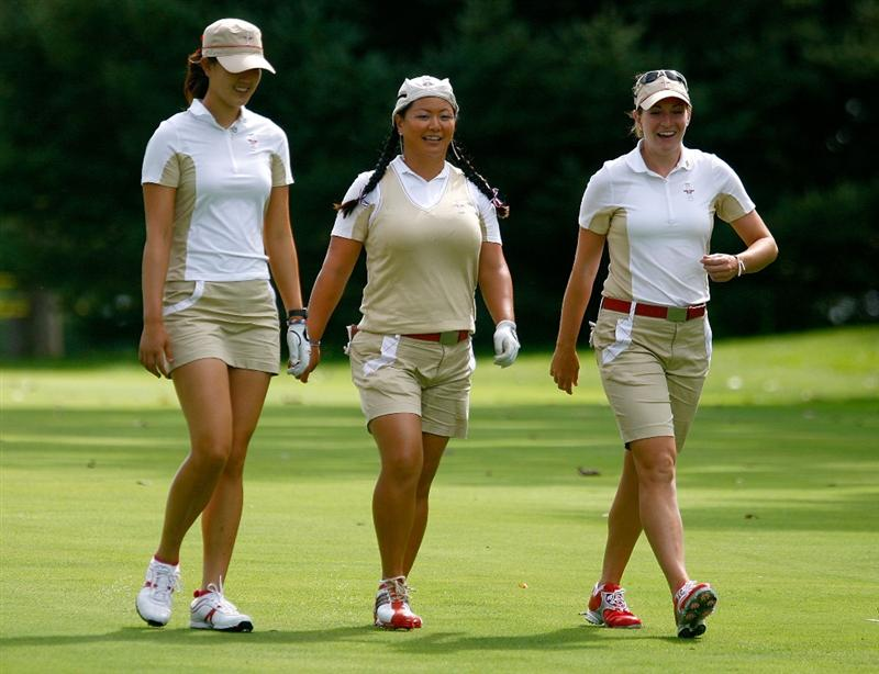 SUGAR GROVE, IL - AUGUST 20:  (L-R) Michelle Wie, Christina Kim and Brittany Lang of the U.S. Team walk down a fairway during a practice round prior to the start of the 2009 Solheim Cup at Rich Harvest Farms on August 20, 2009 in Sugar Grove, Illinois.  (Photo by Scott Halleran/Getty Images)