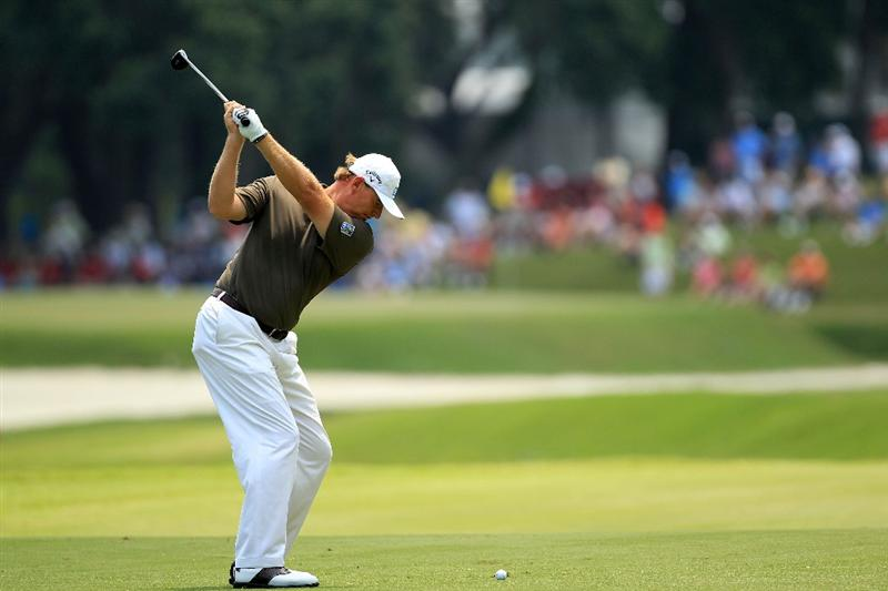 PONTE VEDRA BEACH, FL - MAY 13:  Ernie Els of South Africa hits an approach shot on the 11th hole during the second round of THE PLAYERS Championship held at THE PLAYERS Stadium course at TPC Sawgrass on May 13, 2011 in Ponte Vedra Beach, Florida.  (Photo by Streeter Lecka/Getty Images)