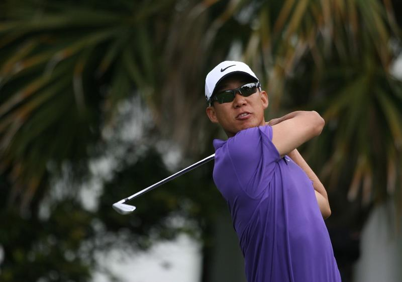 DORAL, FL - MARCH 11:  Anthony Kim tees off on the 13th tee box during round one of the 2010 WGC-CA Championship at the TPC Blue Monster at Doral on March 11, 2010 in Doral, Florida.  (Photo by Marc Serota/Getty Images)