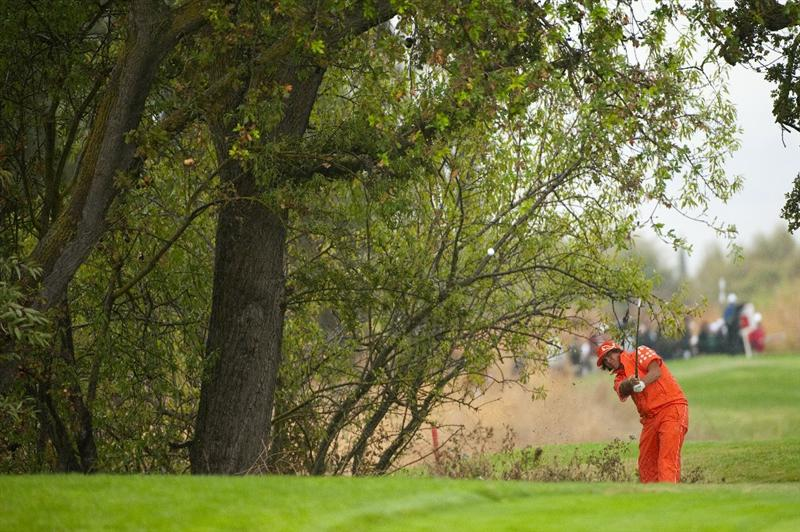 SAN MARTIN, CA - OCTOBER 17:  Rickie Fowler makes a shot out of the rough on the 12th hole during the final round of the Frys.com Open at the CordeValle Golf Club on October 17, 2010 in San Martin, California.  (Photo by Robert Laberge/Getty Images)