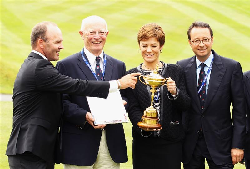 VIRGINIA WATER, ENGLAND - MAY 17: Past Ryder Cup Player Thomas Levet (l) touches the Ryder Cup trophy while Chairman of the French Golf Federation Georges Barbaret, French Minister of Sport Chantal Jouanno and Chairman of the French Ryder Cup bid Pascal Grizot  looks on after France won the right to host the 2018 Ryder Cup tournament, at Wentworth on May 17, 2011 in Virginia Water, England.  (Photo by Bryn Lennon/Getty Images)