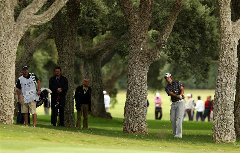 SOTOGRANDE, SPAIN - OCTOBER 30:  Gary Boyd of England plays from under the trees on the 1st  during the third round of the Andalucia Valderrama Masters at Club de Golf Valderrama on October 30, 2010 in Sotogrande, Spain.  (Photo by Richard Heathcote/Getty Images)