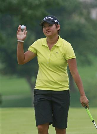ROGERS, AR - SEPTEMBER 12:  Yani Tseng waves after making a birdie on the 18th green during second round play in the P&G Beauty NW Arkansas Championship at the Pinnacle Country Club on September 12, 2009 in Rogers, Arkansas.  (Photo by Dave Martin/Getty Images)