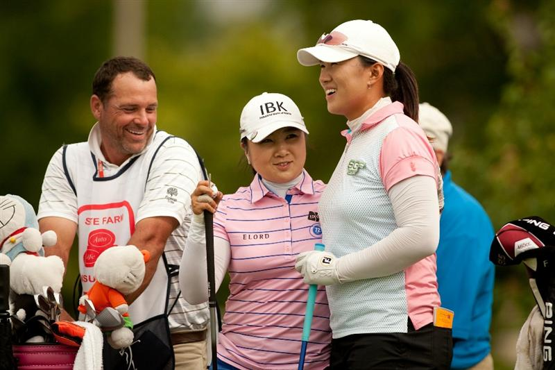 SPRINGFIELD, IL - JUNE 11: Amy Yang and Jeong Jang of South Korea laugh while waiting on the ninth teeduring the second round of the LPGA State Farm Classic at Panther Creek Country Club on June 11, 2010 in Springfield, Illinois. (Photo by Darren Carroll/Getty Images)