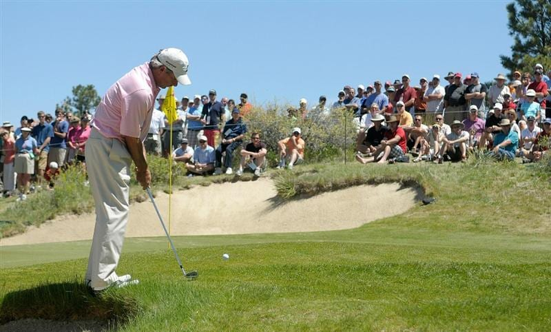 PARKER, CO. - MAY 29: Fred Couples hits a delicate chip shot to the par three second hole hole during the third round of the Senior PGA Championship at the Colorado Golf Club on May 29, 2010 in Parker, Colorado.  (Photo by Marc Feldman/Getty Images)