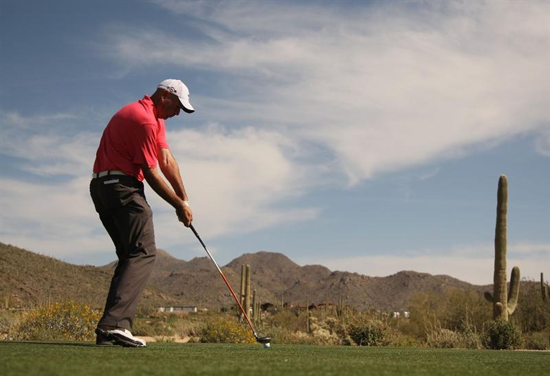 MARANA, AZ - FEBRUARY 19: Stewart Cink tees off on the ninth tee box during round three of the Accenture Match Play Championship at the Ritz-Carlton Golf Club on February 19, 2010 in Marana, Arizona.  (Photo by Darren Carroll/Getty Images)
