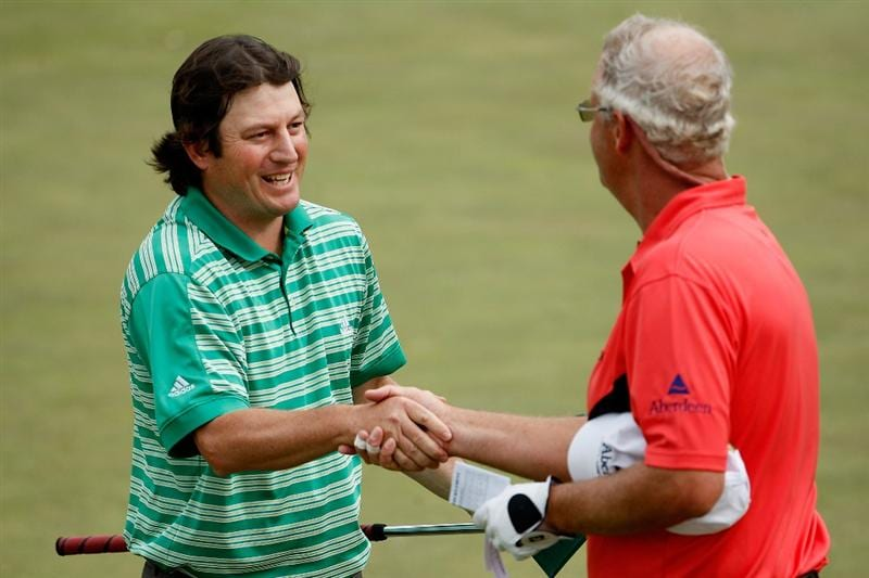 AUGUSTA, GA - APRIL 10:  Tim Clark of South Africa shakes hands with Sandy Lyle of Scotland on the 18th hole after completing their second round of the 2009 Masters Tournament at Augusta National Golf Club on April 10, 2009 in Augusta, Georgia.  (Photo by Jamie Squire/Getty Images)