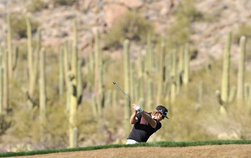 MARANA, AZ - FEBRUARY 25:  Hunter Mahan plays his approach shot on the 14th hole during the third round of the Accenture Match Play Championship at the Ritz-Carlton Golf Club on February 25, 2011 in Marana, Arizona.  (Photo by Stuart Franklin/Getty Images)