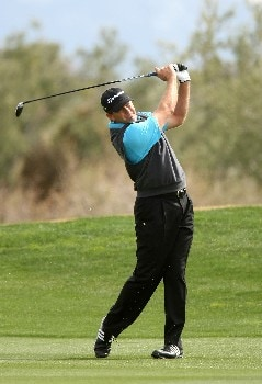MARANA, AZ - FEBRUARY 20:  Retief Goosen of South Africa hits his second shot on the first hole during the first round matches of the WGC-Accenture Match Play Championship at The Gallery at Dove Mountain on February 20, 2008 in Marana, Arizona.  (Photo by Stephen Dunn/Getty Images)