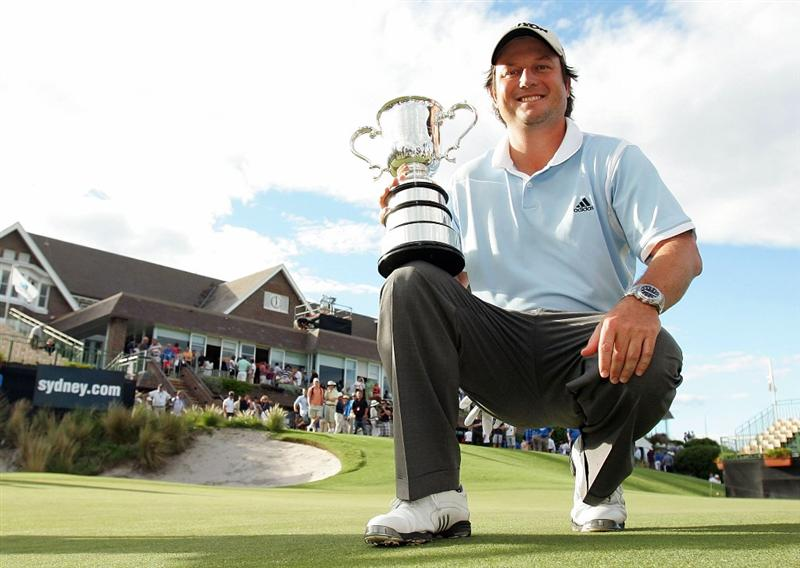 SYDNEY, AUSTRALIA - DECEMBER 14: Tim Clark of South Africa poses with the trophy  after winning the 2008 Australian Open at The Royal Sydney Golf Club on December 14, 2008 in Sydney, Australia.  (Photo by Mark Nolan/Getty Images)