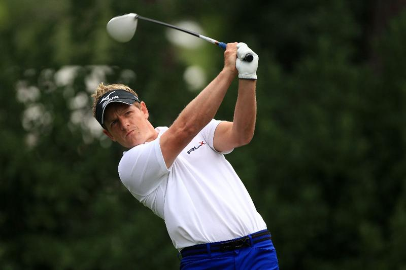 PONTE VEDRA BEACH, FL - MAY 15:  Luke Donald of England hits his tee shot on the 11th hole during the continuation of the third round of THE PLAYERS Championship held at THE PLAYERS Stadium course at TPC Sawgrass on May 15, 2011 in Ponte Vedra Beach, Florida.  (Photo by Streeter Lecka/Getty Images)