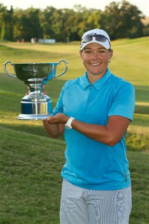 PRATTVILLE, AL - OCTOBER 10: Katherine Hull of Australia holds the champion's trophy following her victory at the Navistar LPGA Classic at the Senator Course at the Robert Trent Jones Golf Trail on October 10, 2010 in Prattville, Alabama. (Photo by Darren Carroll/Getty Images)