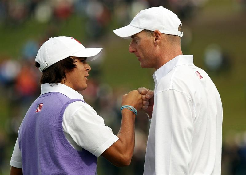 NEWPORT, WALES - OCTOBER 02:  Rickie Fowler (L) of the USA is congratulated by Jim Furyk on the 18th green after they halved their match during the rescheduled Afternoon Foursome Matches during the 2010 Ryder Cup at the Celtic Manor Resort on October 2, 2010 in Newport, Wales.  (Photo by Ross Kinnaird/Getty Images)