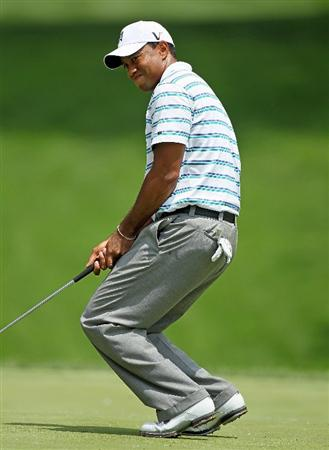 DUBLIN, OH - JUNE 04:  Tiger Woods reacts after missing his birdie putt shot on the eighth hole during the second round of The Memorial Tournament presented by Morgan Stanley at Muirfield Village Golf Club on June 4, 2010 in Dublin, Ohio.  (Photo by Andy Lyons/Getty Images)
