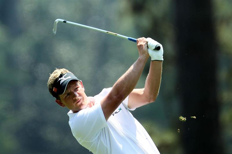 AUGUSTA, GA - APRIL 10:  Luke Donald of England hits his approach shot on the first hole during the final round of the 2011 Masters Tournament at Augusta National Golf Club on April 10, 2011 in Augusta, Georgia.  (Photo by Jamie Squire/Getty Images)