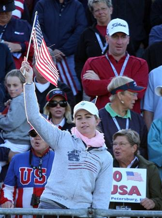 SUGAR GROVE, IL - AUGUST 22:  Paula Creamer of the U.S. Team leads the cheering fans above the first tee during the saturday afternoon fourball matches at the 2009 Solheim Cup at Rich Harvest Farms on August 22, 2009 in Sugar Grove, Illinois.  (Photo by David Cannon/Getty Images)