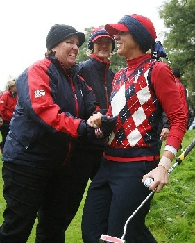 HALMSTAD, SWEDEN - SEPTEMBER 16:  USA Team coaches Meg Mallon and Beth Daniel celebrate with Nicole Castrale after securing the Solheim Cup for the USA during the singles matches of the 2007 Solheim Cup at on September 16, 2007 in Halmstad, Sweden.  (Photo by Scott Halleran/Getty Images)