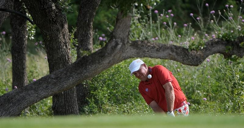 SAN ANTONIO, TX - MAY 15:  John Daly hits out of the rough on the drivable par four 5th hole during the second round of the Valero Texas Open at the TPC San Antonio on May 15, 2010 in San Antonio, Texas. (Photo by Marc Feldman/Getty Images)