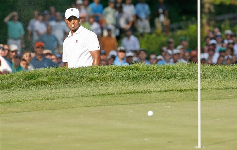 NORTON, MA - SEPTEMBER 5:  Tiger Woods works out of a bunker onto the 11th green during the second round of the Deutsche Bank Championship held at TPC Boston on September 5, 2009 in Norton, Massachusetts. (Photo by Jim Rogash/Getty Images)