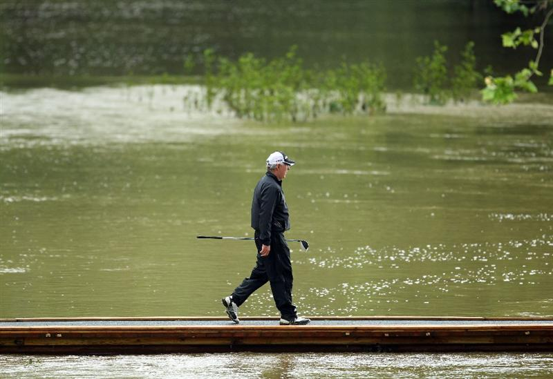LOUISVILLE, KY - MAY 27:  Hale Irwin walks on the bridge from the 9th tee to the fairway during the second round of the Senior PGA Championship presented by KitchenAid at Valhalla Golf Club on May 27, 2011 in Louisville, Kentucky.  (Photo by Andy Lyons/Getty Images)