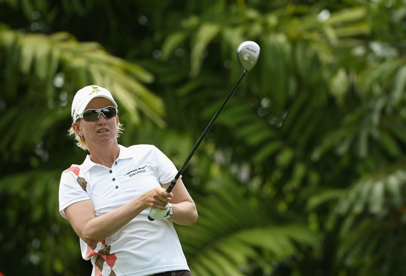 SINGAPORE - FEBRUARY 24:  Karrie Webb of Australia hits her tee-shot on the seventh hole during the first round of the HSBC Women's Champions at the Tanah Merah Country Club on February 24, 2011 in Singapore.  (Photo by Andrew Redington/Getty Images)