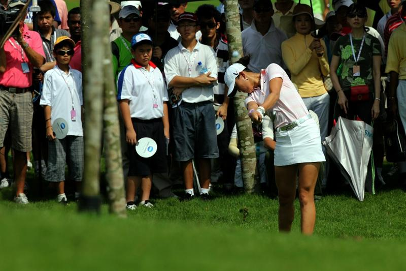 KUALA LUMPUR, MALAYSIA - OCTOBER 23 : Michelle Wie of USA hits her 2nd shot out of the rough on the 3rd hole during Round Two of the Sime Darby LPGA on October 23, 2010 at the Kuala Lumpur Golf and Country Club in Kuala Lumpur, Malaysia. (Photo by Stanley Chou/Getty Images)