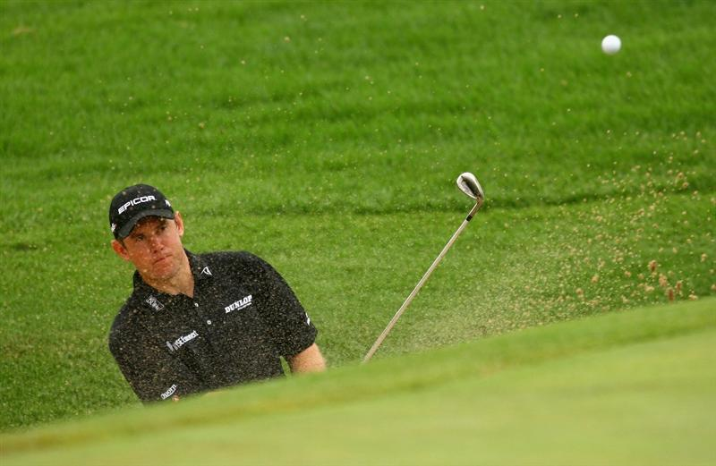 NELSPRUIT, SOUTH AFRICA - DECEMBER 12:  Lee Westwood of England plays out of the 15th grenside bunker during the second round of the Alfred Dunhill Championship at Leopard Creek Country Club on December 12, 2008 in Malelane, South Africa.  (Photo by Warren Little/Getty Images)