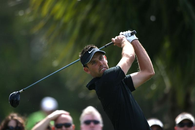 DORAL, FL - MARCH 14:  Charl Schwartzel of South Africa tees off on the third tee box during the final round of the 2010 WGC-CA Championship at the TPC Blue Monster at Doral on March 14, 2010 in Doral, Florida.  (Photo by Marc Serota/Getty Images)