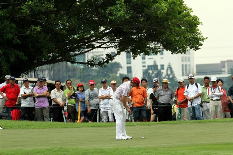 KUALA LUMPUR, MALAYSIA - OCTOBER 30: Ricky Barnes of USA putts on the 13th hole during day three of the CIMB Asia Pacific Classic at The MINES Resort & Golf Club on October 30, 2010 in Kuala Lumpur, Malaysia. (Photo by Stanley Chou/Getty Images)
