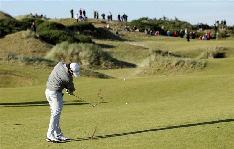 KINGSBARNS, SCOTLAND - OCTOBER 07:  Rory McIlroy of Northern Ireland plays his second shot to the 17th green during the first round of The Alfred Dunhill Links Championship at Kingsbarns Golf Links on October 7, 2010 in Kingsbarns, Scotland.  (Photo by Andrew Redington/Getty Images)