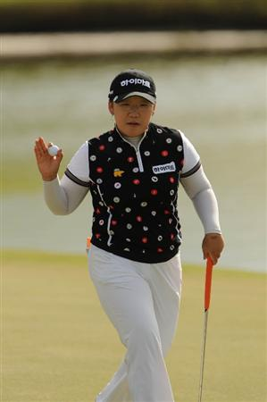 WEST PALM BECH, FL - NOVEMBER 23:  Ji-Yai Shin of South Korea waves to the gallery after a birdie putt on the 16th hole during the final round of the ADT Championship at the Trump International Golf Club on November 23, 2008 in West Palm Beach, Florida.  (Photo by Montana Pritchard/Getty Images)