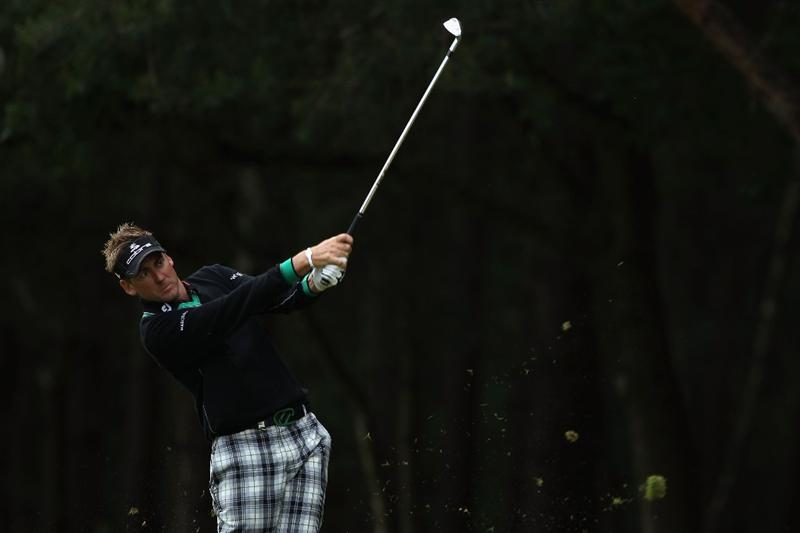 VIRGINIA WATER, ENGLAND - MAY 26: Ian Poulter of England plays an approach shot on the 13th hole during the first round of the BMW PGA Championship at Wentworth Club on May 26, 2011 in Virginia Water, England.  (Photo by Warren Little/Getty Images)