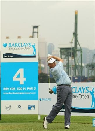 SINGAPORE - NOVEMBER 11:  Colin Montgomerie of Scotland in action during the First Round of the Barclays Singapore Open at Sentosa Golf Club on November 11, 2010 in Singapore, Singapore.  (Photo by Ian Walton/Getty Images)