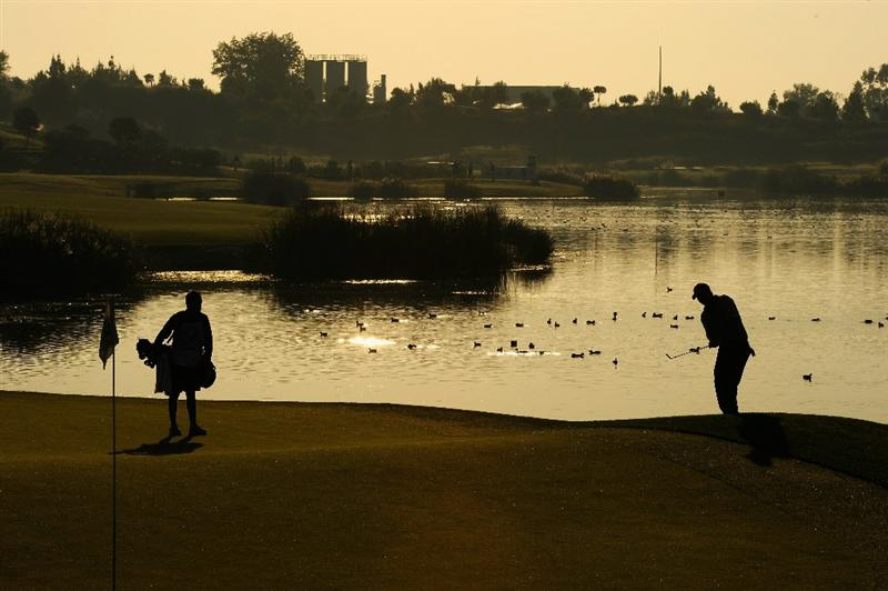 VILLAMOURA, PORTUGAL - OCTOBER 15:  Ross McGowan of England plays his chip shot on the 11th hole during the second round of the Portugal Masters at the Oceanico Victoria Golf Course on October 15, 2010 in Villamoura, Portugal.