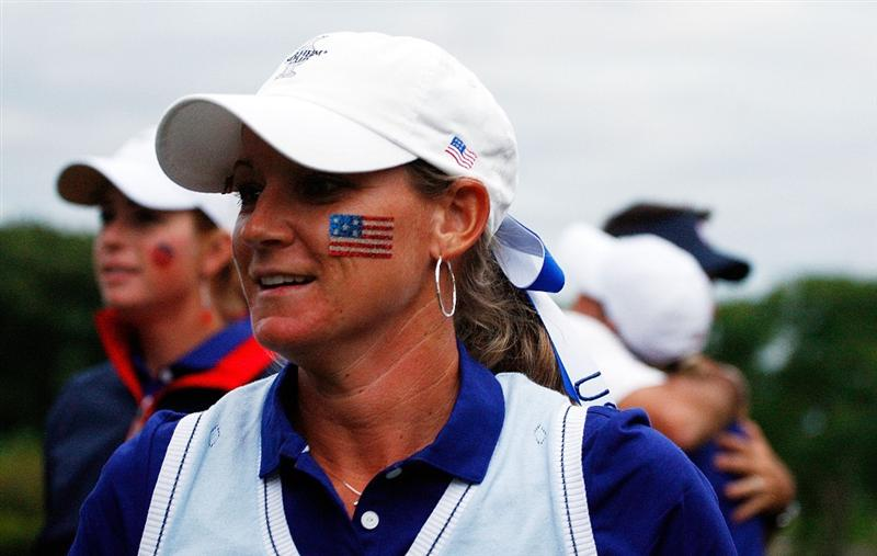 SUGAR GROVE, IL - AUGUST 22:  Kristy McPherson of the U.S. Team walks off the 18th green after winning her match with Morgan Pressel over Alfredsson and Pettersen 2up during the saturday afternoon foursomes matches at the 2009 Solheim Cup at Rich Harvest Farms on August 22, 2009 in Sugar Grove, Illinois.  (Photo by Scott Halleran/Getty Images)