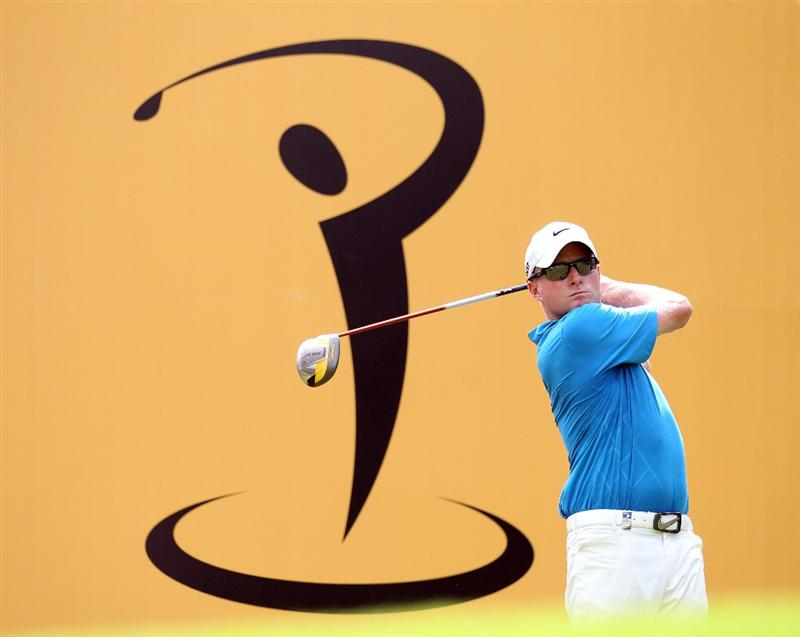 KUALA LUMPUR, MALAYSIA - APRIL 13:  Simon Dyson of England in action during a practice round ahead of the Maybank Malaysian Open at Kuala Lumpur Golf & Country Club on April 13, 2011 in Kuala Lumpur, Malaysia.  (Photo by Ian Walton/Getty Images)