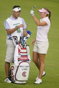 Brittany Lang pulls a club from her bag as caddie and brother Luke discuss the approach shot on the 18th hole during the second round of the Wegmans LPGA at Locust Hill Country Club in Rochester, New York on Friday, June 23, 2006.Photo by Kevin Rivoli/WireImage.com