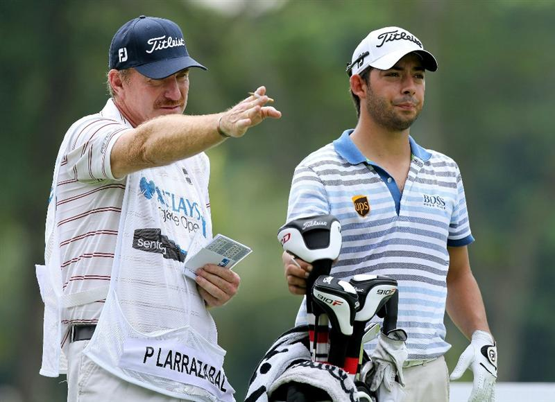 SINGAPORE - NOVEMBER 12 : Pablo Larrazabal of Spain listens to his caddie on the 14th hole during the second round of the Barclays Singapore Open held at the Sentosa Golf Club on November 12, 2010 in Singapore, Singapore.  (Photo by Stanley Chou/Getty Images)