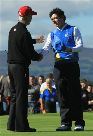 NEWPORT, WALES - OCTOBER 04:  Rory McIlroy of Europe shakes hands with USA Captain Corey Pavin on the 18th green after he halved his match in the singles matches during the 2010 Ryder Cup at the Celtic Manor Resort on October 4, 2010 in Newport, Wales.  (Photo by David Cannon/Getty Images)