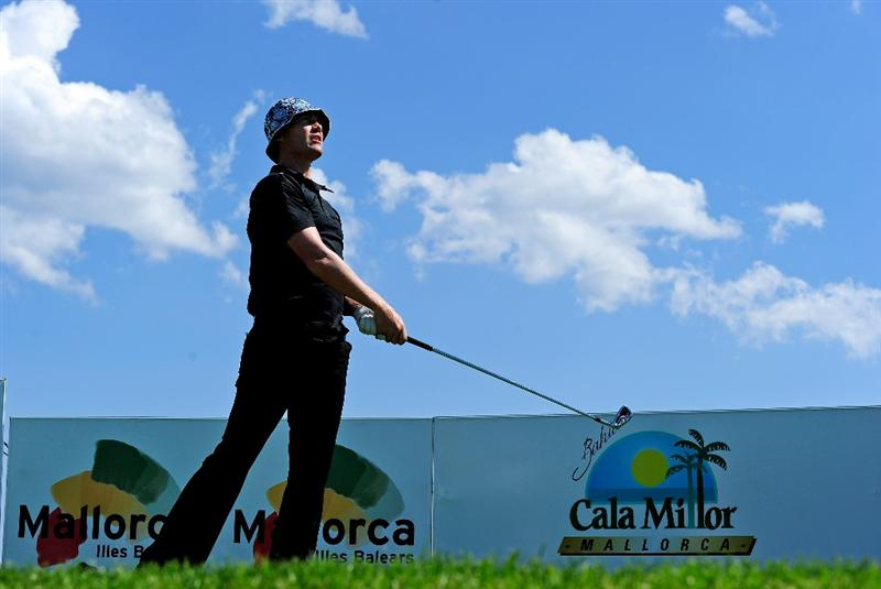 MALLORCA, SPAIN - MAY 13:  Peter Gustafsson of Sweden plays his tee shot on the 13th hole during the first round of the Open Cala Millor Mallorca at Pula golf club on May 13, 2010 in Mallorca, Spain.  (Photo by Stuart Franklin/Getty Images)