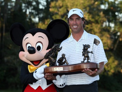 Stephen Ames of Canada receives the trophy from Mickey Mouse after the final round of The Children's Miracle Network Classic held on the Palm and Magnolia Courses at The Disney Shades of Green Resort, on November 4, 2007 in Lake Buena Vista, Florida, PGA TOUR - 2007 Children's Miracle Network Classic presented by Wal-Mart - Final RoundPhoto by David Cannon/WireImage.com