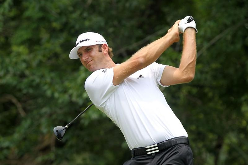 PONTE VEDRA BEACH, FL - MAY 14:  Dustin Johnson hits a tee shot on the fifth hole during the third round of THE PLAYERS Championship held at THE PLAYERS Stadium course at TPC Sawgrass on May 14, 2011 in Ponte Vedra Beach, Florida.  (Photo by Scott Halleran/Getty Images)