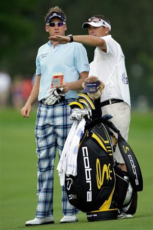 CHASKA, MN - AUGUST 13:  Ian Poulter of England chats with his caddie Terry Mundy on the seventh hole during the first round of the 91st PGA Championship at Hazeltine National Golf Club on August 13, 2009 in Chaska, Minnesota.  (Photo by Jamie Squire/Getty Images)