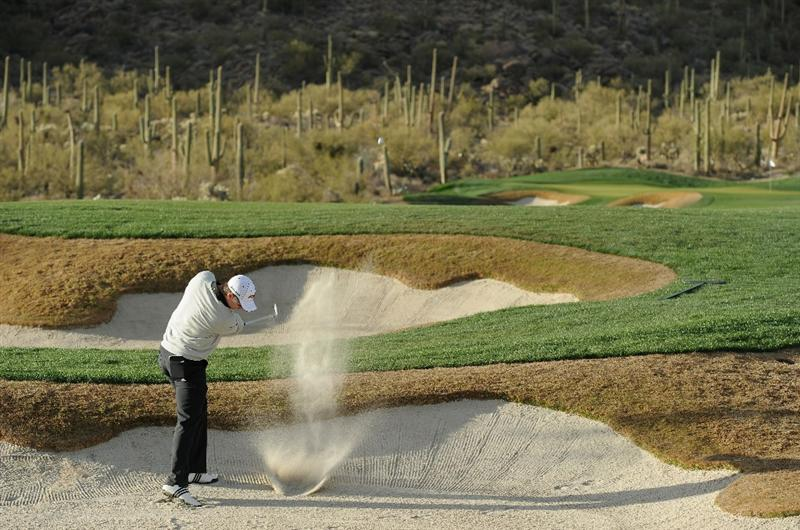 MARANA, AZ - FEBRUARY 23:  Justin Rose of England plays his bunker shot on the 14th hole during the first round of the World Golf Championships-Accenture Match Play Championship held at The Ritz-Carlton Golf Club, Dove Mountain on February 23, 2011 in Marana, Arizona.  (Photo by Stuart Franklin/Getty Images)